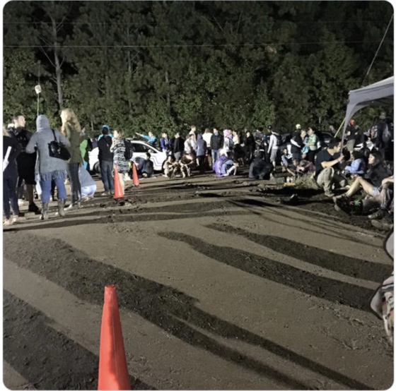 """""""A photo of attendees sleeping in the mud after Tomorrow World while waiting for their cabs. The event management fail here is lack of arrangements for emergency evacuation."""""""
